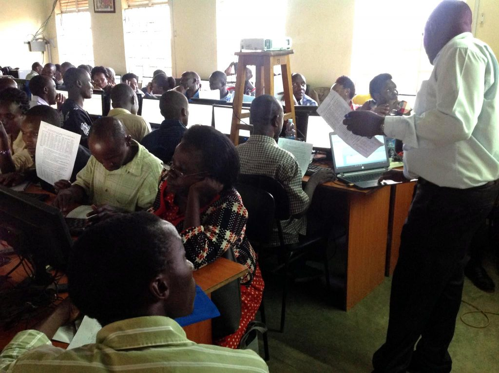Teachers in a past retooling workshop at Kololo SSS